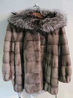 Blue iris mink jacket with drawstring and fox trimmed hood