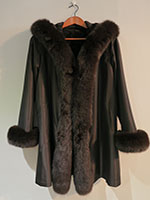 Reversible brown sheared mink coat with fox trim and hood
