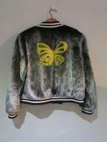 Metallic silver mink bomber with butterfly motif