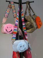 Leather cross body bag with mink smiley