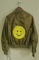Upcycled khaki green bomber with yellow mink smiley