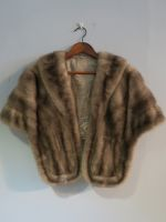 Mink wrap with hidden pockets and pie crust detail