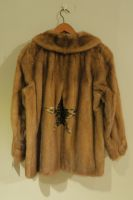 Light caramel mink jacket with leopard print star detail